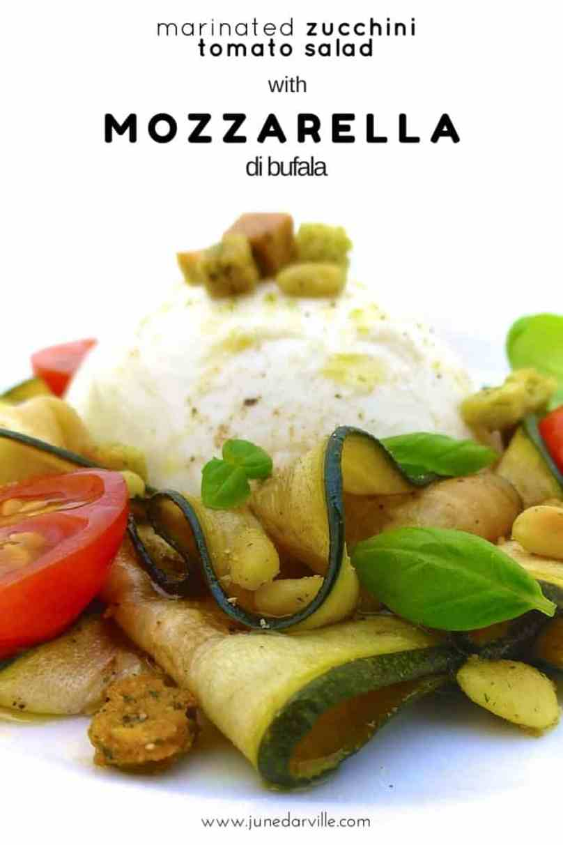 Mozzarella di bufala, cherry tomatoes and marinated zucchini with pine nuts, fresh basil and herbed croutons: a tasty zucchini tomato mozzarella salad!