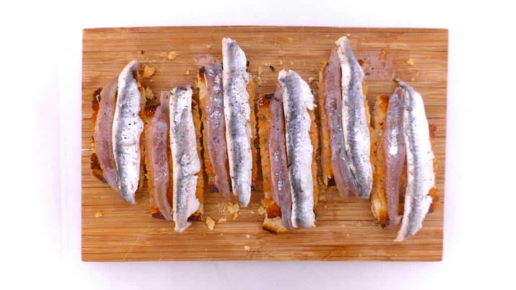 Crunchy Spanish tosta matrimonio or pickled anchovies and salted anchovies on a slice of pan con tomate, the perfect wedding!