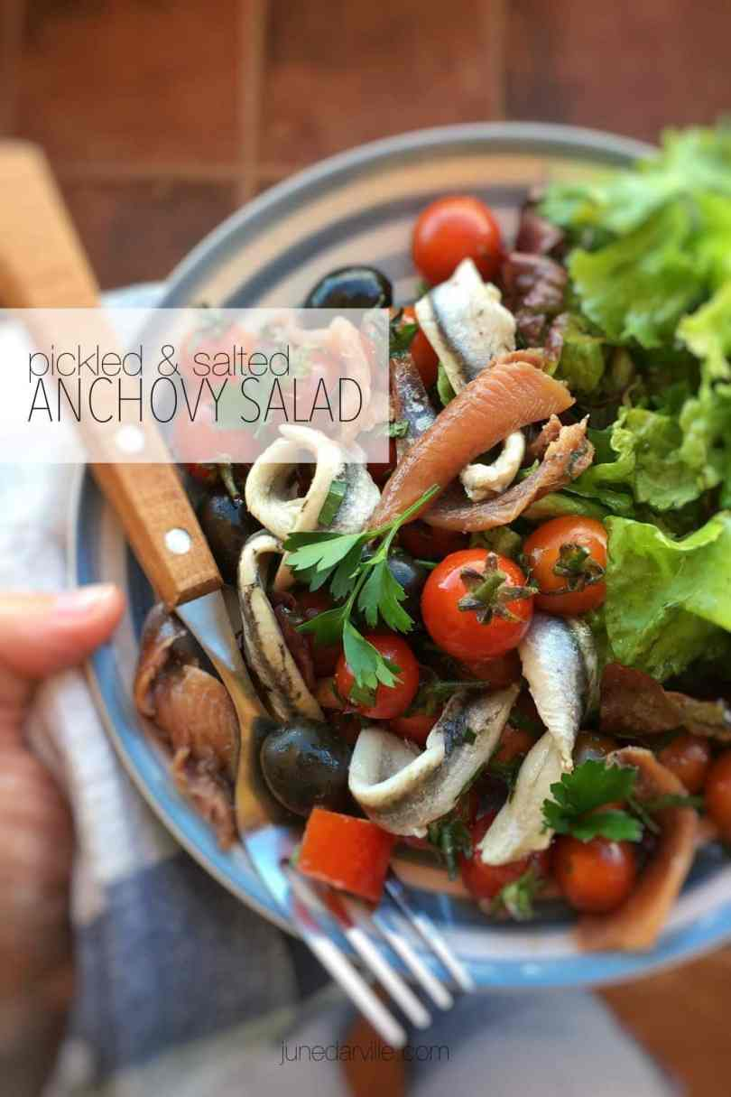 This anchovy salad with tomatoes and black olives is a great lunch treat for a hot summer day! You should try this combo, it's a fantastic flavor explosion!