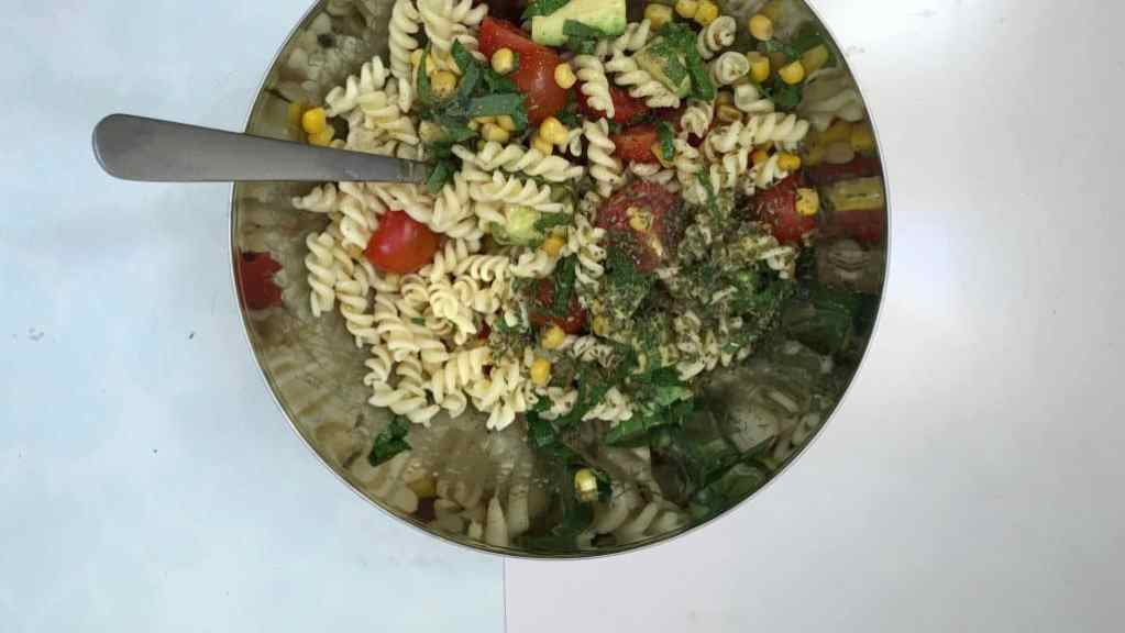 Leftover cooked fusilli pasta from last night's dinner? Makes a great fusilli pasta salad for lunch with tomatoes, basil and avocado!