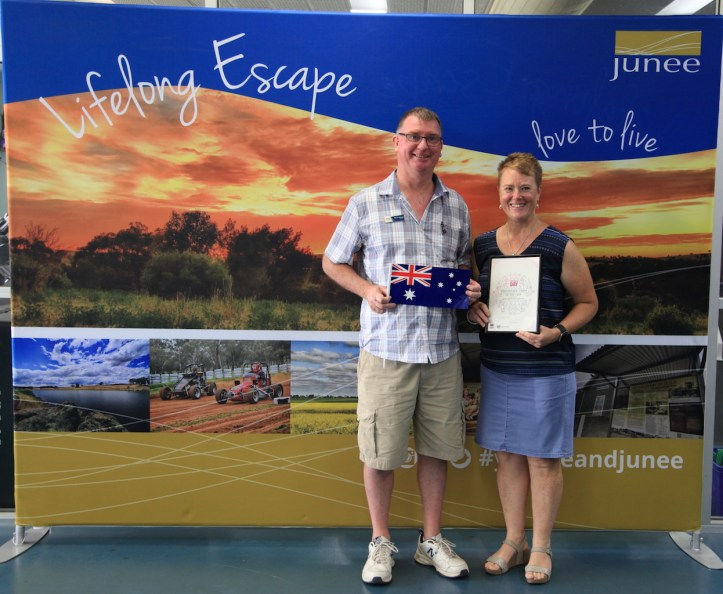 """Martin Holmes and Jen Hoy with Junee Community Power's """"Junee Volunteer Team of the Year"""" Award January 26, 2019. Photo by Ben O'Malley"""