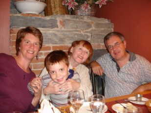 With Malcolm and his parents in 2004