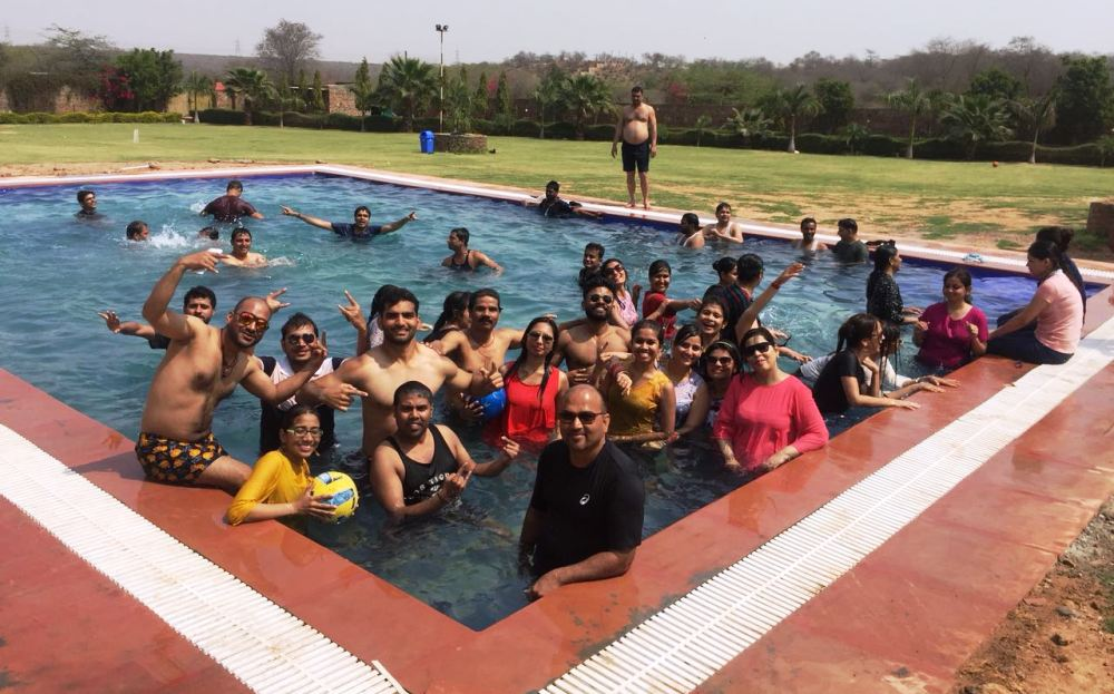 Group Enjoying Pool Party near Delhi at Jungle Adventure Retreat