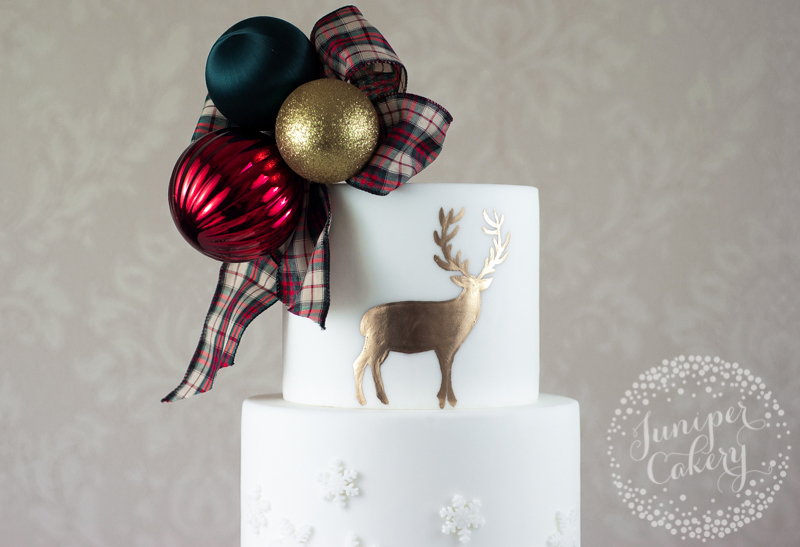Golden stag painted highland Christmas cake by Juniper Cakery