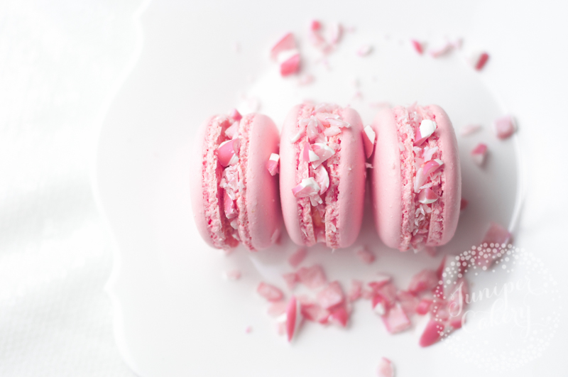 Pretty pink candy cane macarons by Juniper Cakery