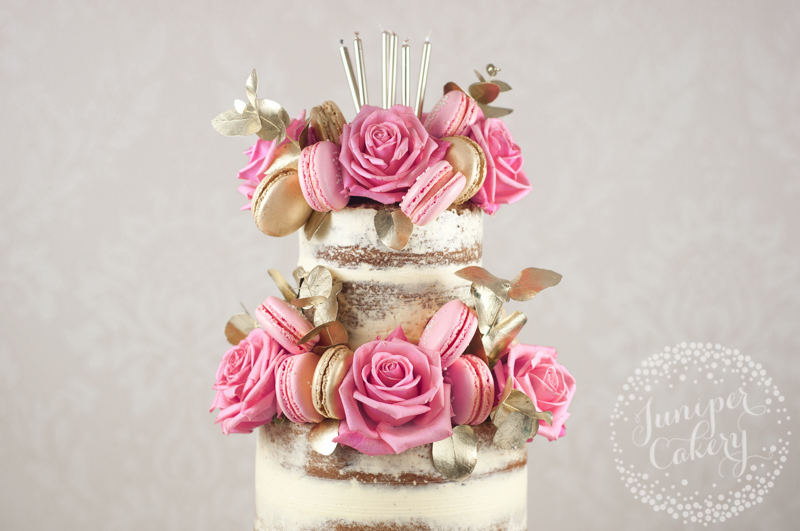 Pretty pink and gold naked cake by Juniper Cakery