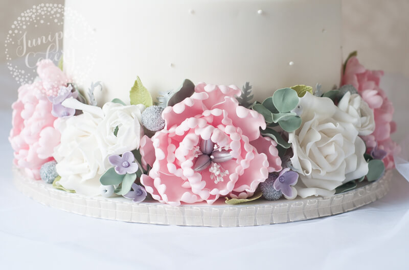 Sugar peony and rose wedding cake design by Juniper Cakery