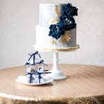 Stylish Marbled Wedding Cake With Gold And Navy Peonies