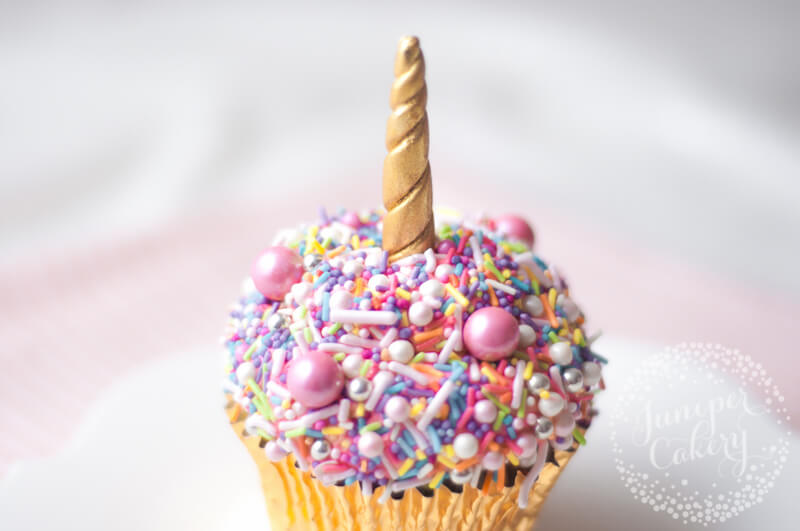Quick rainbow sprinkle unicorn cupcake tutorial by Juniper Cakery
