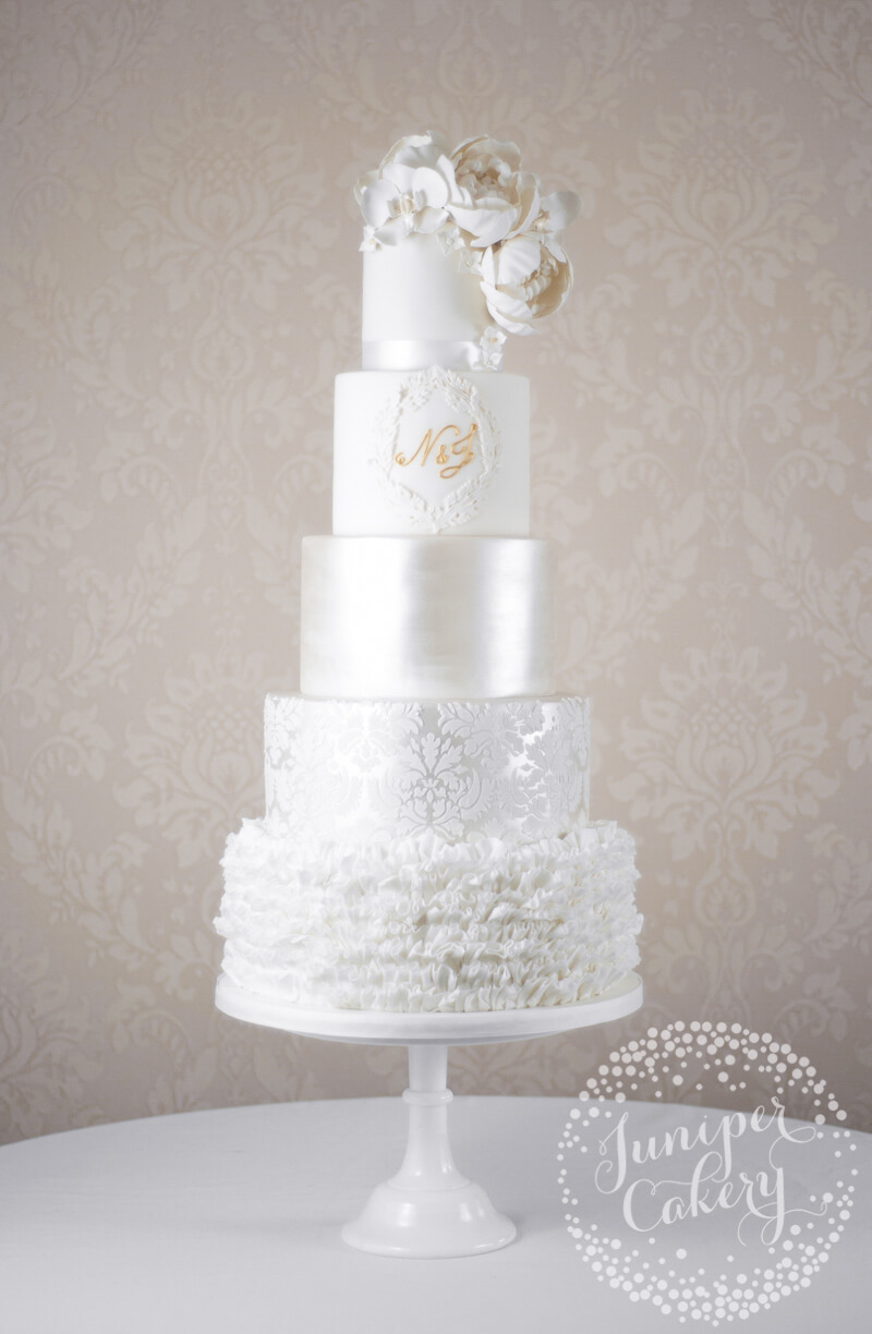 Glamorous and grand white wedding cake by Juniper Cakery