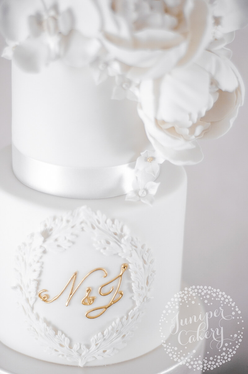 Elegant white wedding cake by Juniper Cakery