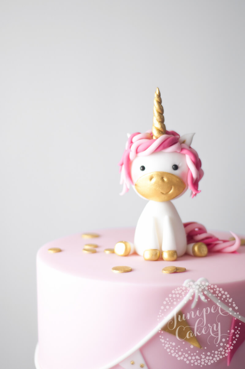 Adorable pink and gold unicorn Christening cake by Juniper Cakery