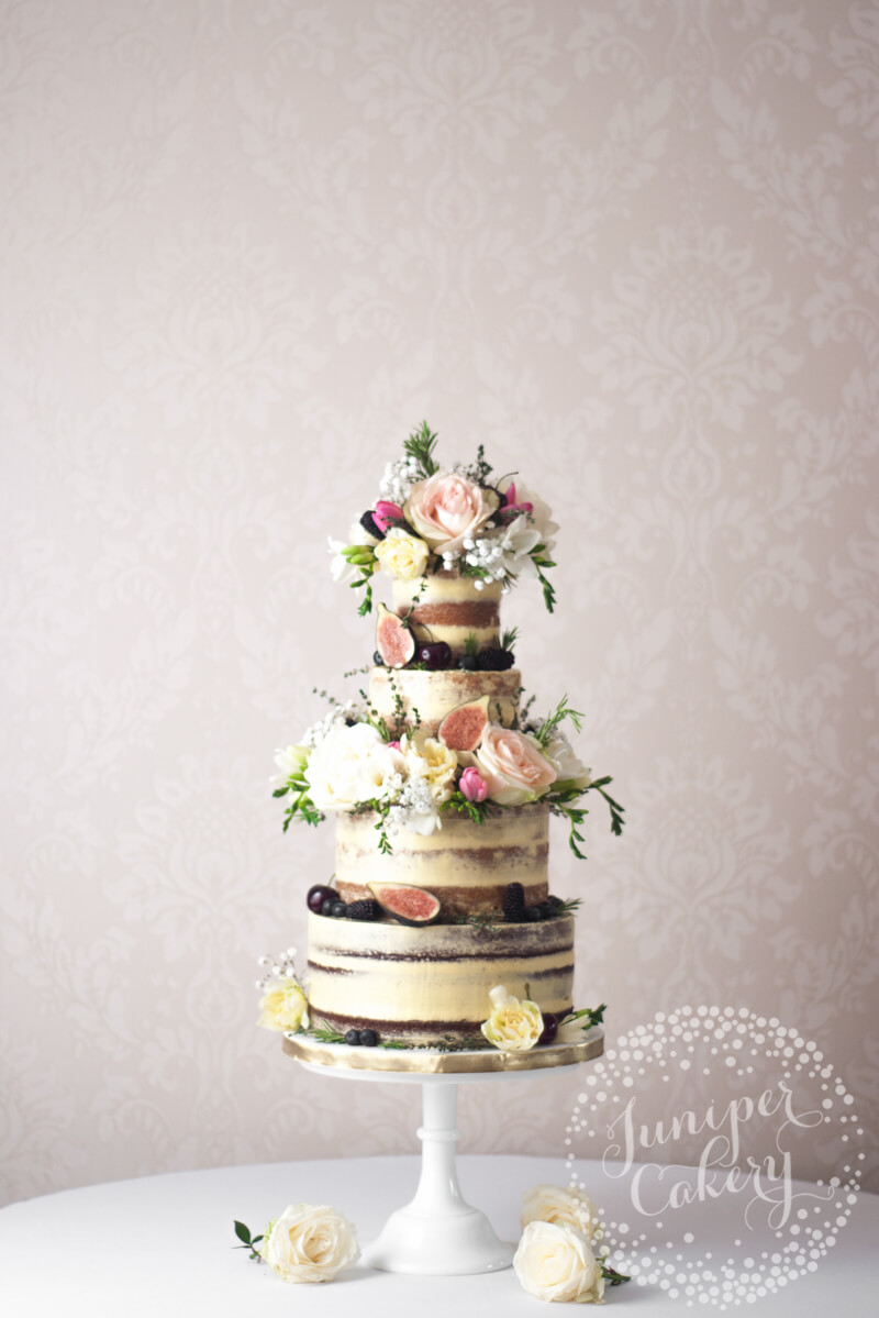 Pretty English garden semi-naked wedding cake by Juniper Cakery