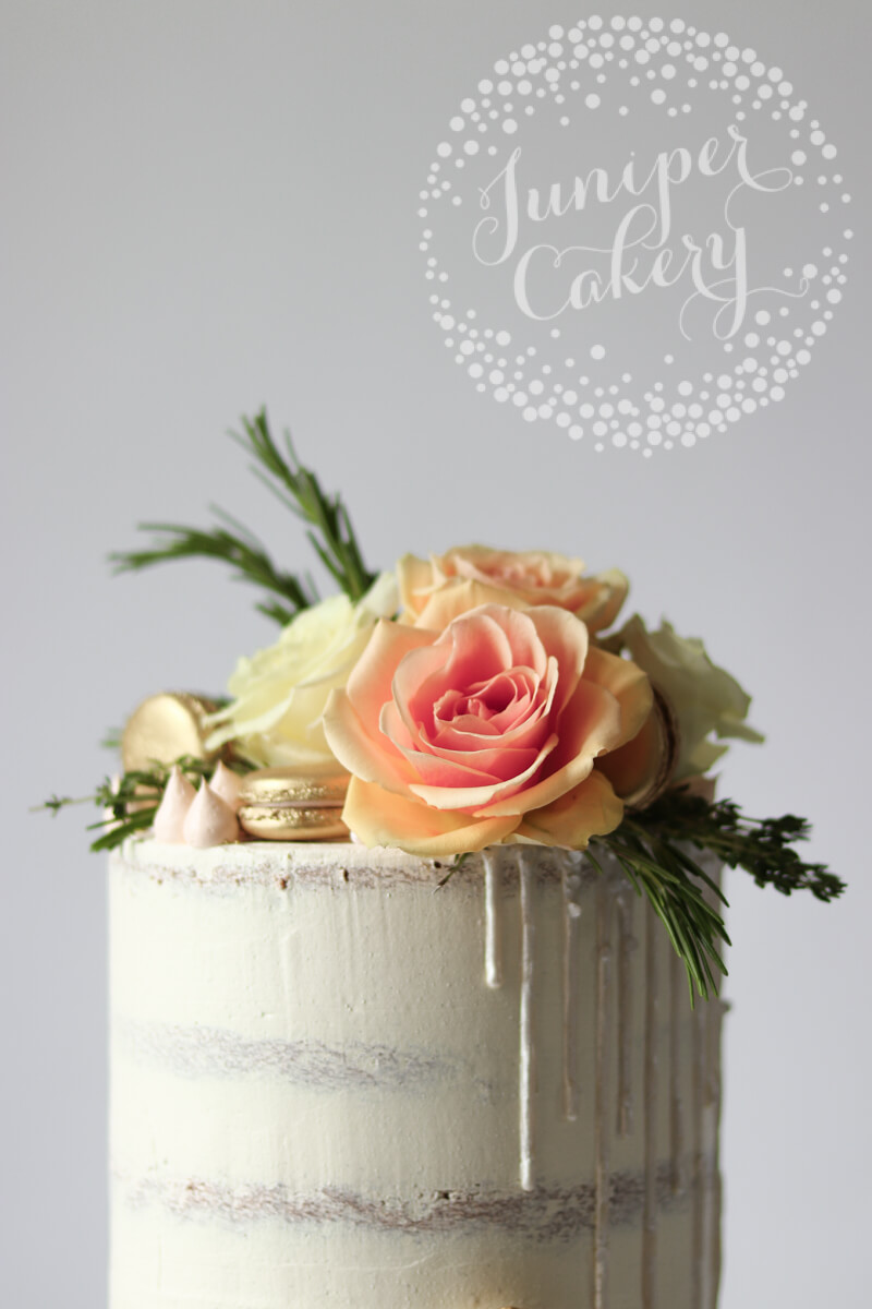 Pretty white on white semi-naked cake by Juniper Cakery