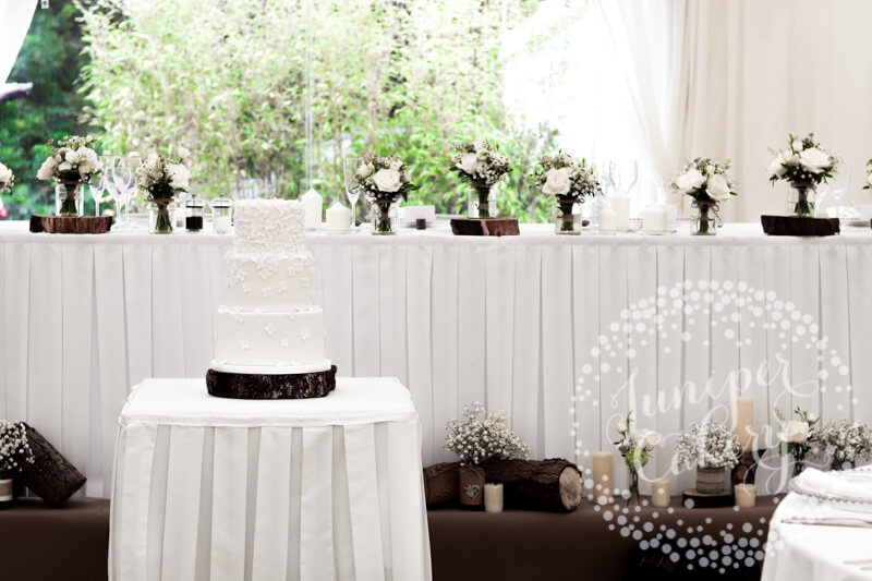 Pretty white blossom wedding cake by Juniper Cakery