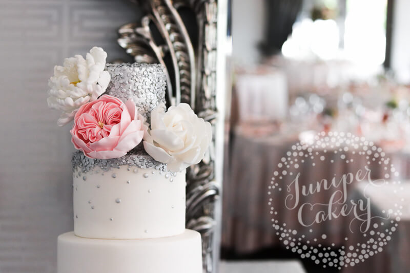 Silver sequin wedding cake with sugar flowers by Juniper Cakery