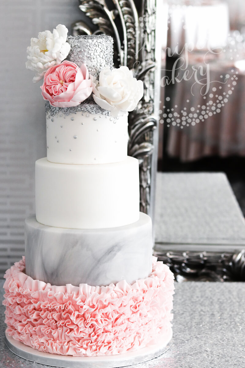 Chic pink ruffle wedding cake by Juniper Cakery