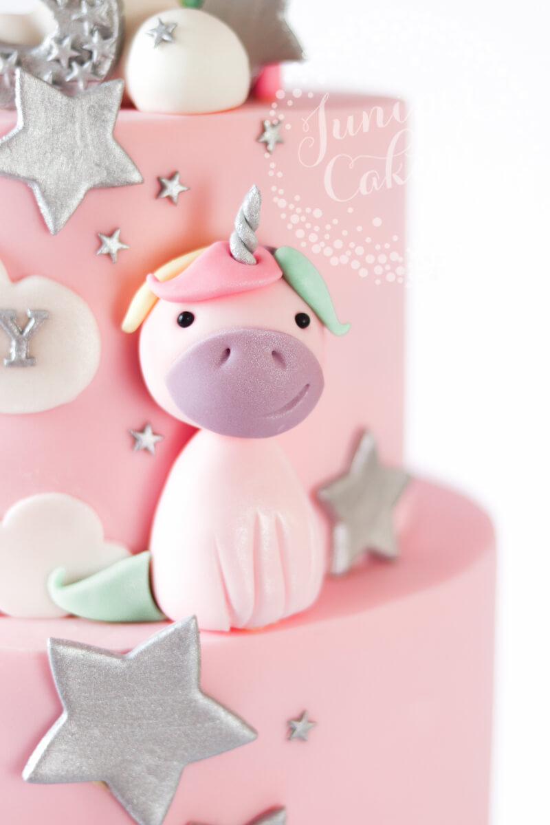 Pale rainbow unicorn party cake by Juniper Cakery