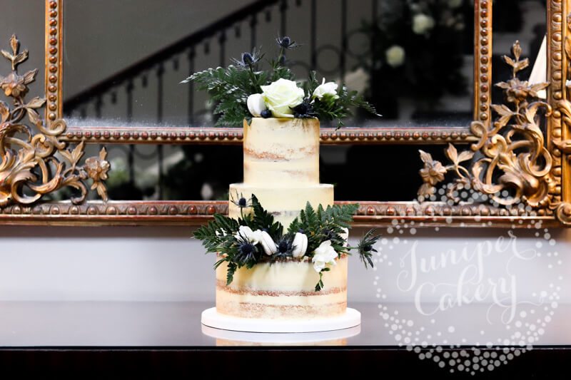 Wild and chic thistle semi-naked wedding cake at Saltmarshe Hall by Juniper Cakery