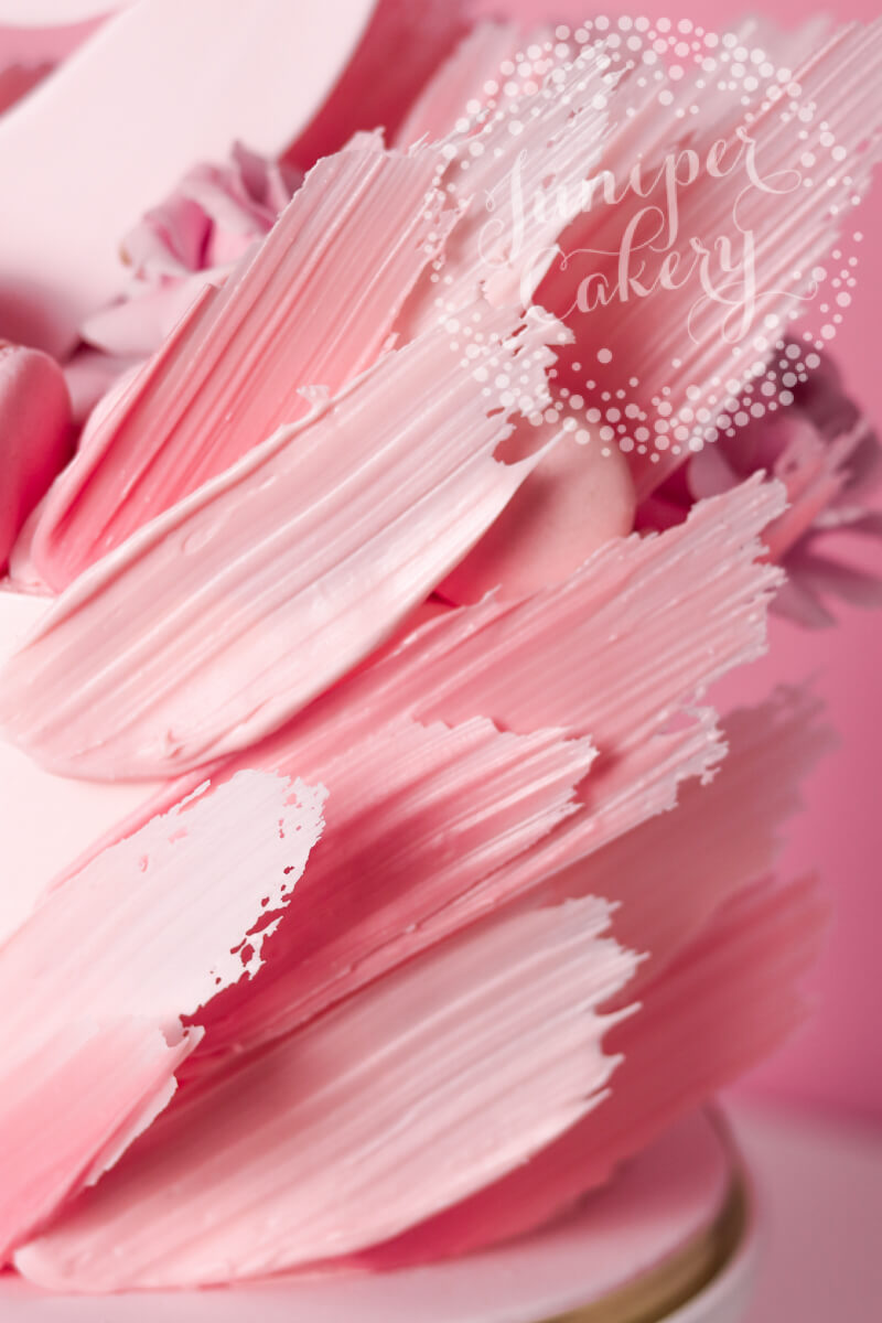 Flamingo cake with pink candy melt feathers by Juniper Cakery