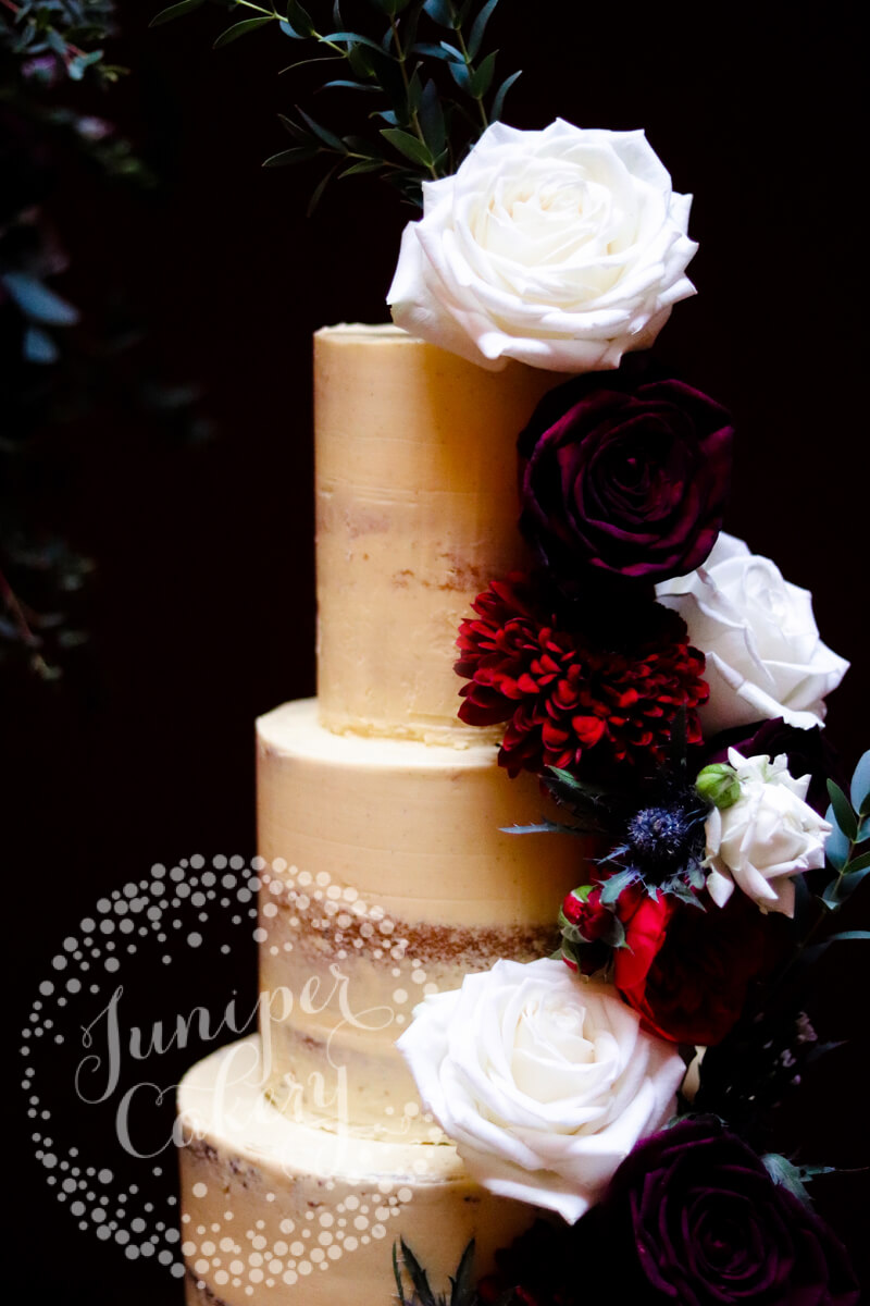 Dramatic burgundy and navy wedding cake by Juniper Cakery