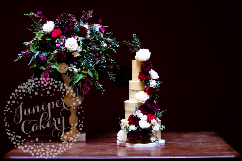 Dramatic berry, burgundy and navy wedding cake by Juniper Cakery at Rise Hall