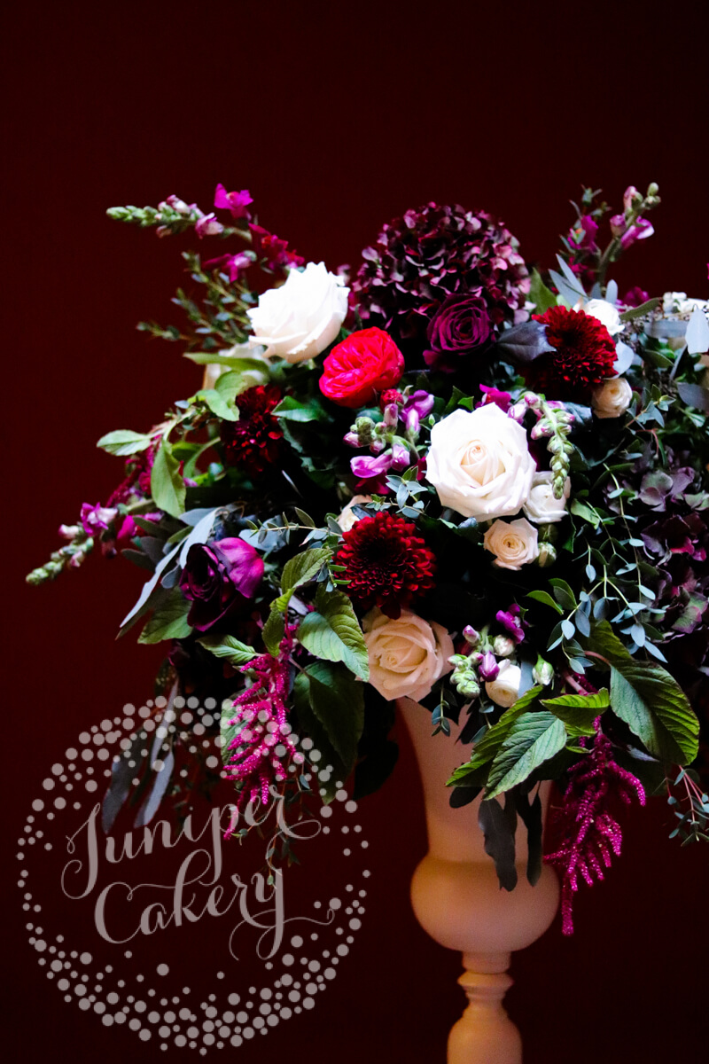 Berry and navy themed wedding at Rise Hall with flowers from Floral Lounge