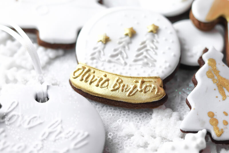 Cute snow glove themed Olivia Burton cookies by Juniper Cakery