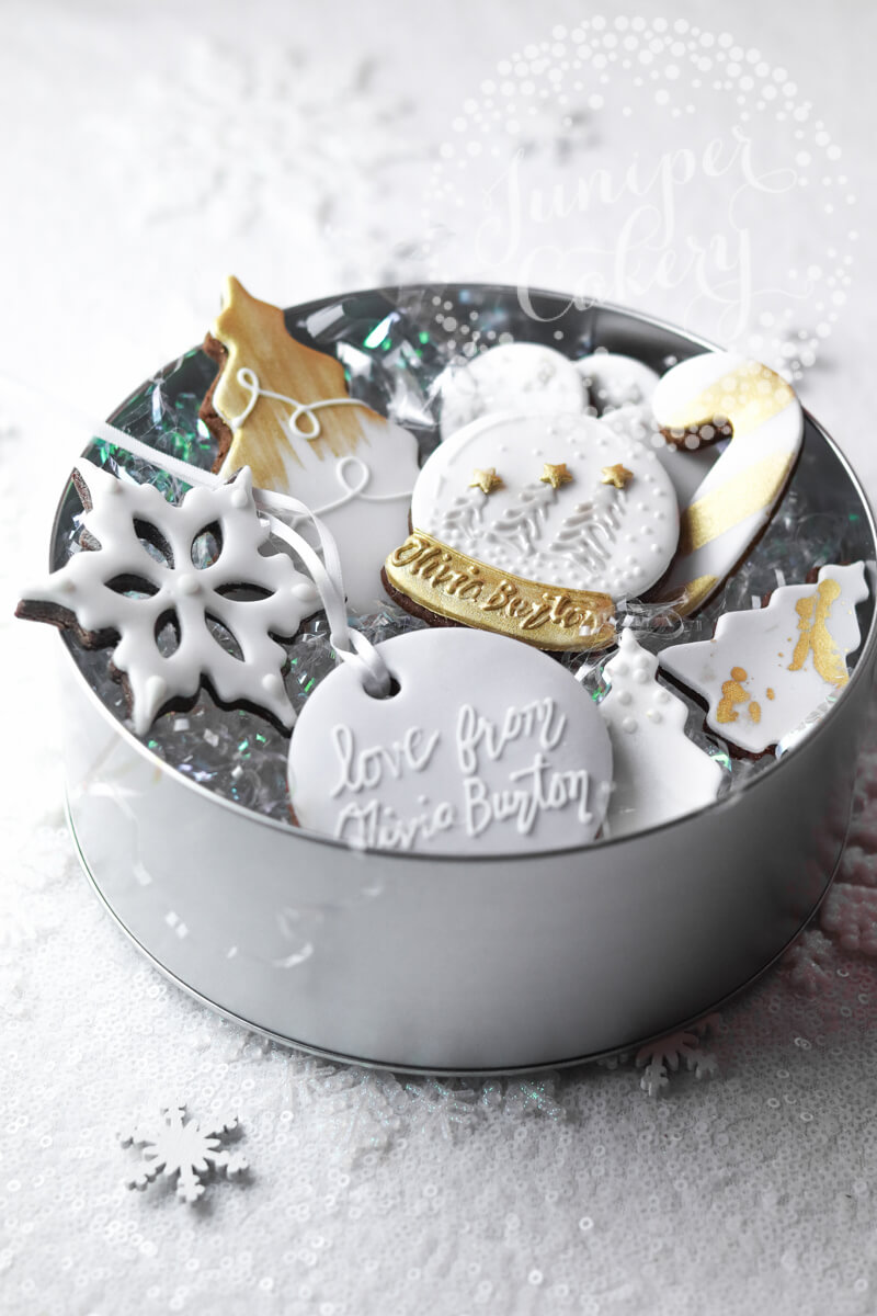 Pretty tin of branded cookies for Olivia Burton London by Juniper Cakery