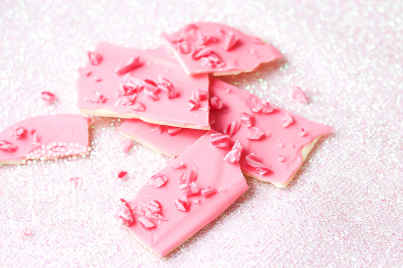 Pink and fun candy cane bark recipe by Juniper Cakery