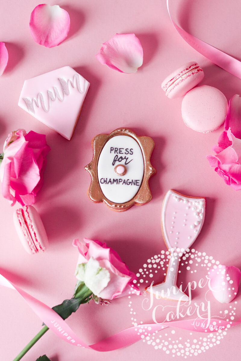 Pretty in pink Mother's Day cookies by Juniper Cakery