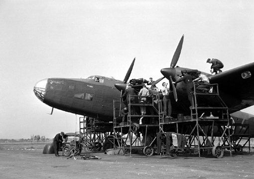 The ground crew doing maintenance work on a Halifax II of No 408 Squadron at Leeming, August 10th, 1943.