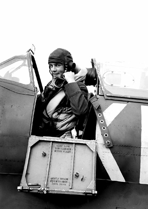 Flying Officer N.R.D. Dick in the cockpit of his Spitfire.