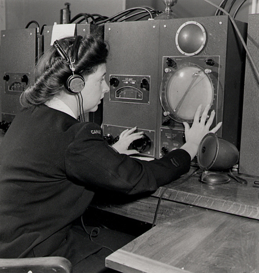 "A ""Wren"" - a member of the WRCNS - operating Direction Finding equipment at HMCS Coverdale station near Moncton, New Brunswick, August 1945."