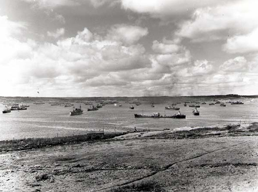 A convoy of merchant ships assembling in Bedford Basin, Halifax, April 1941.
