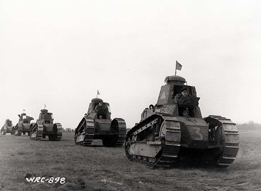 Canadian Army owned few and obsolete tanks. Here, Renault tanks are demonstrated for federal Members of Parliament at Camp Borden, Ontario, May 14th, 1941.