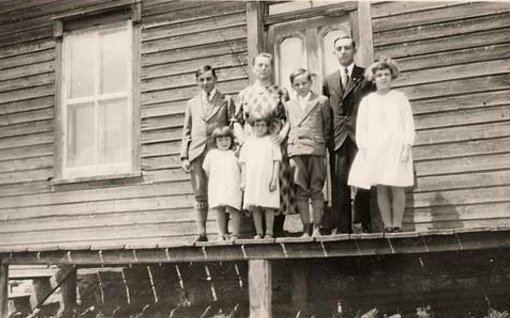 Blandine Matteau and her children in front of the family home in Sainte-Clothilde, Quebec, around 1936.