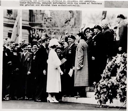 "Their Majesties King George VI and Queen Elizabeth mingle informally with the crowd following the unveiling ceremony of the National War Memorial in Ottawa, 21 May 1939. On this occasion, Governor-General Lord Tweedsmuir wrote to a friend: ""It was wonderful to see old fellows weeping, and crying 'Ay, man, if Hitler could see this.'"""