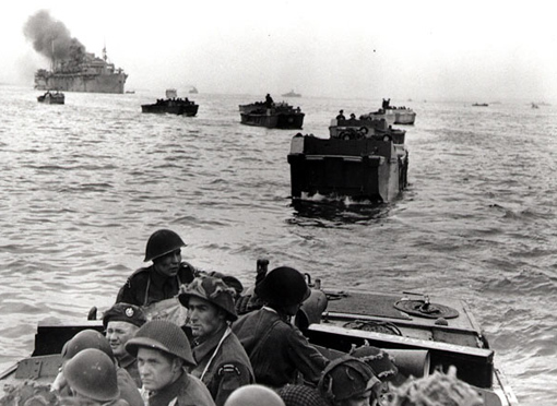 On board their assault landing crafts, men of the Royal Winnipeg Rifles heading towards their sector of Juno Beach, June 6th, 1944.