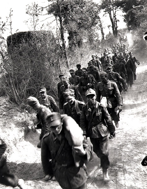 A column of German troops captured near Ifs, Normandy, 8 August 1944.