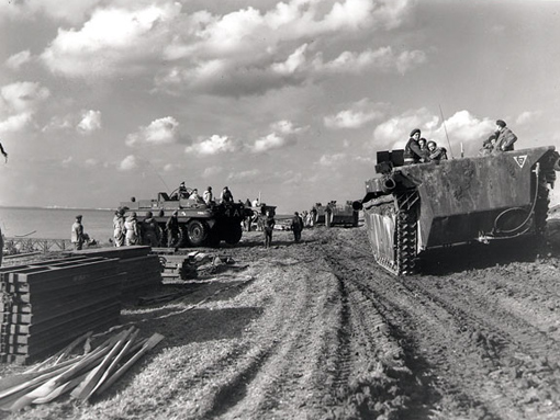 A column of Alligators passing Terrepin amphibious vehicles on the Scheldt River near Terneuzen, October 13th,1944.