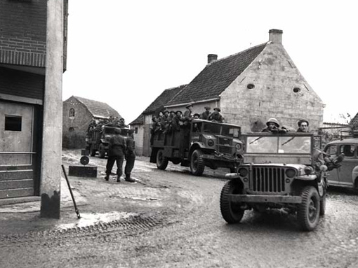 The 7th Brigade is moving through a village in the vicinity of Leopold canal, October 18th, 1944.