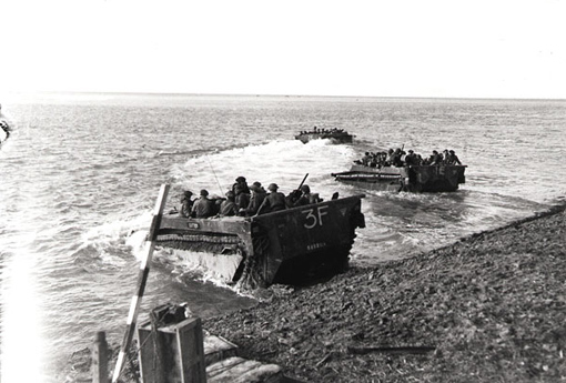 Buffalo amphibious vehicles carrying troops across the Scheldt to Hoofdplaat, October 13th, 1944.