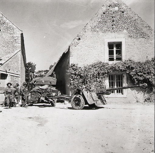 Personnel of the Royal Canadian Artillery with a 17-pounder anti-tank gun in Normandy, 22 June 1944.