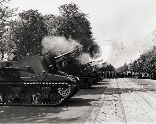Sexton SP guns of the 8th Field Regiment, R.C.A., firing 21 gun salute to celebrate VE Day, Groningen, Netherlands, 8 May 1945.