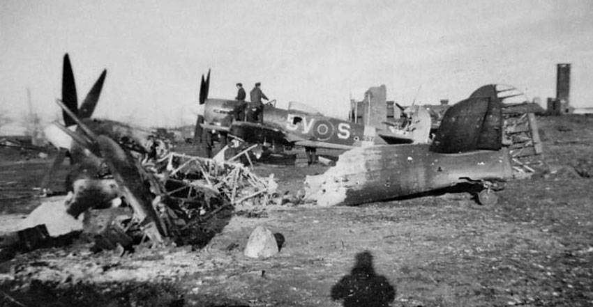 Destroyed and damaged Hawker Typhoons of 439 Squadron RCAF after the Luftwaffe's New Year's Day strike at B-78 airfield, Eindhoven, Holland.