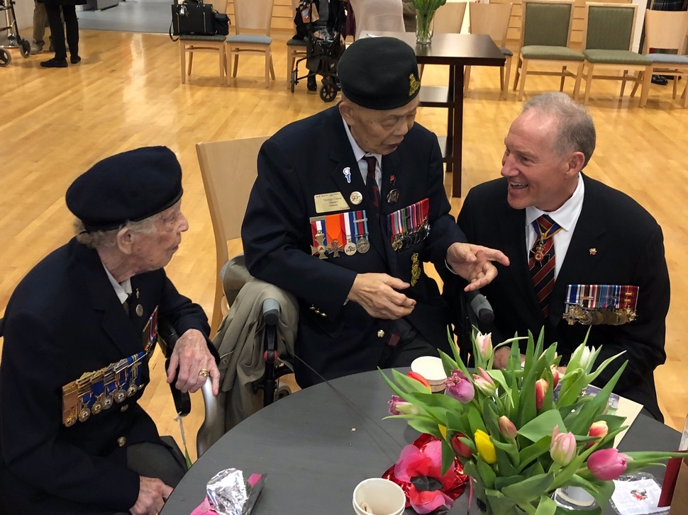 Second World War Veteran Agnes Keegan visits with D-Day Veteran George Chow and Deputy Minister of Veterans Affairs Walt Natynczyk. Both WW2 veterans have visited the Juno Beach Centre museum for commemorations.