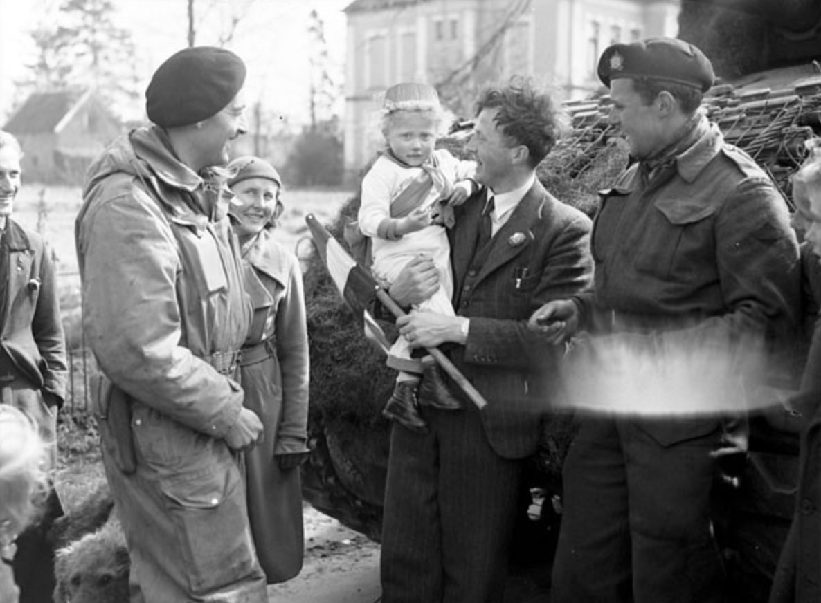 A Canadian soldier with the Fort Garry Horse offering gum to Dutch child during the liberation in World War 2