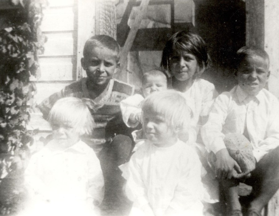 Top row left to right: oldest brother August (Gus), Emanuel (infant), oldest sister Margaret (holding Emanuel), brother Andrew (Andy). Front row left to right: sister Edith, cousin, Frieda.