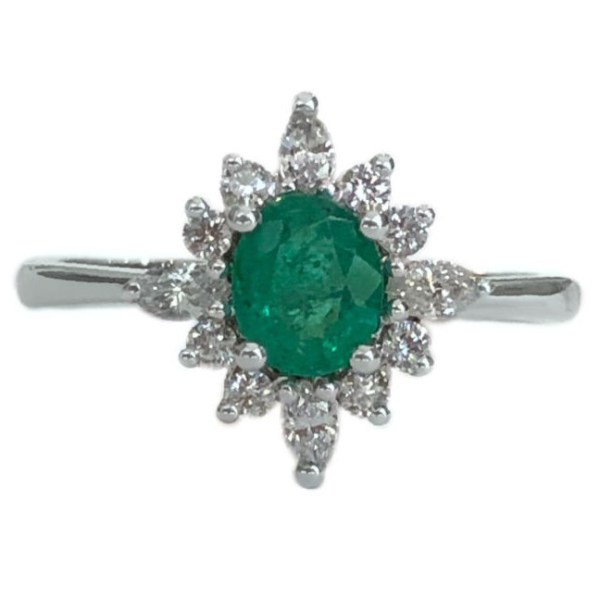 oval emerald ring .45 carat with round and pear shape diamond halo